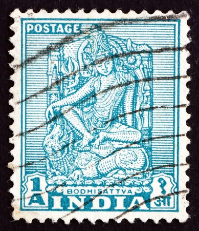 indian postal stamp: INDIA - CIRCA 1950: a stamp printed in India shows Bodhisattva, Sculpture of Bodhisattva, Enlightenment Being, circa 1950 Editorial
