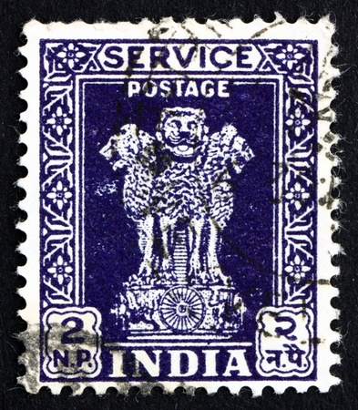 ashoka: INDIA - CIRCA 1957: a stamp printed in India shows Lion Capital of Ashoka Pillar from Sarnath, National Emblem of India, circa 1957 Editorial