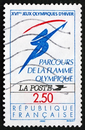flambeau: FRANCE - CIRCA 1991: a stamp printed in the France shows Olympic Flame, 1992 Winter Olympics, Albertville, circa 1991