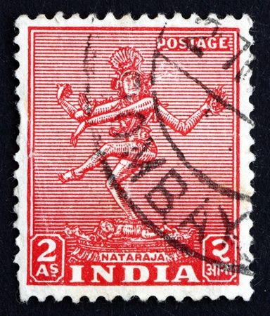 nataraja: INDIA - CIRCA 1949: a stamp printed in India shows Nataraja, the Lord of Dance, Depiction of the God Shiva as the Cosmic Dancer, circa 1949