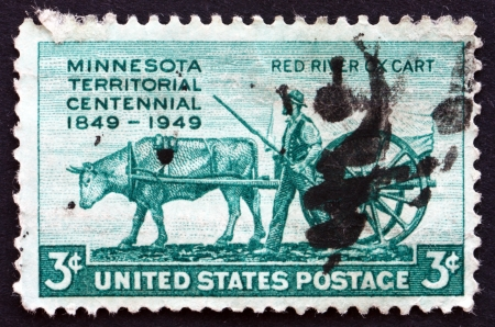 establishment states: UNITED STATES OF AMERICA - CIRCA 1949: a stamp printed in the USA shows Pioneer and Red River Oxcart, Centenary of the Establishment of Minnesota Territory, circa 1961