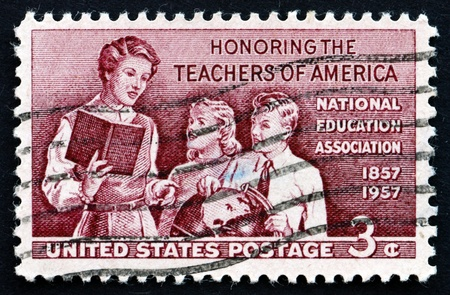 honoring: UNITED STATES OF AMERICA - CIRCA 1957: a stamp printed in the USA shows Teacher and Pupils, Honoring the School Teachers of America, circa 1957
