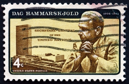 un used: UNITED STATES OF AMERICA - CIRCA 1962: a stamp printed in the USA shows Dag Hammarskjold and UN Headquarters, Secretary General of the United Nations, circa 1962 Editorial