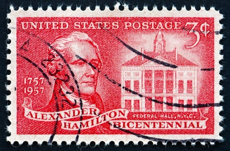 alexander hamilton: UNITED STATES OF AMERICA - CIRCA 1957: a stamp printed in the USA shows Alexander Hamilton and Federal Hall, Founding Father of the United States, circa 1957 Editorial