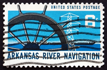UNITED STATES OF AMERICA - CIRCA 1968: a stamp printed in the USA shows Ship�s Wheel, Power Transmission Tower and Barge, Arkansas River Navigation, circa 1968