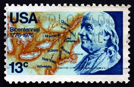 postmaster: UNITED STATES OF AMERICA - CIRCA 1976: a stamp printed in the USA shows Franklin and Map of North America, 1776, American Bicentennial, circa 1976