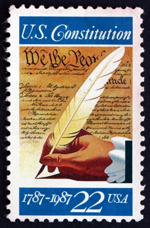 UNITED STATES OF AMERICA - CIRCA 1987: a stamp printed in the USA shows Hand with Quill Pen, Signing of the Constitution, Bicentennial, circa 1987