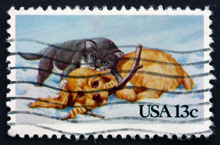 UNITED STATES OF AMERICA - CIRCA 1982: a stamp printed in the USA shows Puppy and Kitty, Christmas, circa 1982