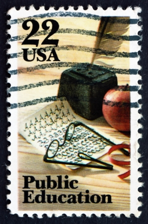penmanship: UNITED STATES OF AMERICA - CIRCA 1985: a stamp printed in the USA shows Quill Pen, Apple, Spectacles and Penmanship Quiz, Public Education, circa 1982