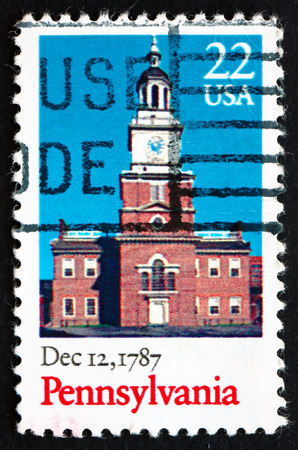 of ratification: UNITED STATES OF AMERICA - CIRCA 1987: a stamp printed in the USA shows Independence Hall, Pennsylvania, December 12, 1787, Bicentennial of the Ratification of the Constitution, circa 1987