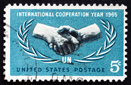 un used: UNITED STATES OF AMERICA - CIRCA 1965: a stamp printed in the USA shows ICY Emblem, 20th Anniversary of the UN, circa 1965 Editorial