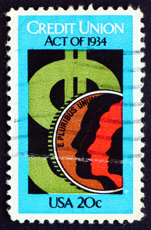 credit union: UNITED STATES OF AMERICA - CIRCA 1984: a stamp printed in the USA shows Dollar Sign and Coin, 50th Anniversary of Credit Union Act, circa 1984