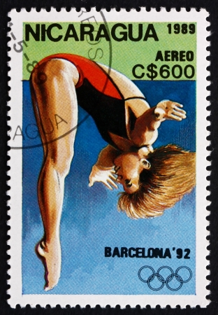 olympiad: NICARAGUA - CIRCA 1989: a stamp printed in Nicaragua shows Diving, 1992 Summer Olympics, Barcelona, Spain, circa 1989