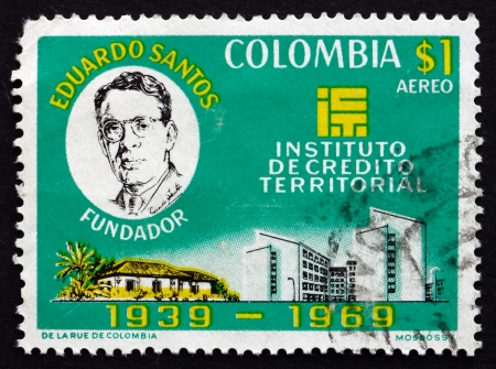 territorial: COLOMBIA - CIRCA 1970: a stamp printed in the Colombia shows Eduardo Santos, Rural and Urban Buildings, Founding of the Territorial Credit Institute, circa 1970 Editorial