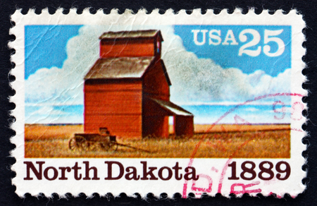 statehood: UNITED STATES OF AMERICA - CIRCA 1989: a stamp printed in the USA shows Barn and Fields from North Dakota, Centennial of Statehood, circa 1989