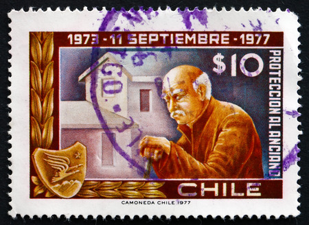armed services: CHILE - CIRCA 1977: a stamp printed in the Chile shows Old Man and Home, 4th Anniversary of Government Junta and Social Services of Armed Forces, circa 1977