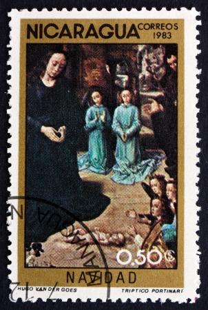 hugo: NICARAGUA - CIRCA 1983: a stamp printed in Nicaragua shows Adoration of the Kings, Painting by Hugo van der Goes, Christmas, circa 1983