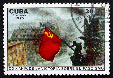 fascism: CUBA - CIRCA 1975: a stamp printed in the Cuba shows Raising Red Flag over Reichstag, Berlin, Victory over Fascism, 30th Anniversary, circa 1975 Editorial