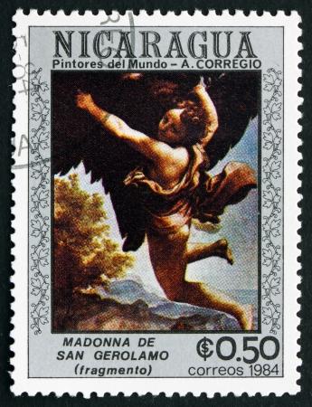 NICARAGUA - CIRCA 1984: a stamp printed in Nicaragua shows Madonna of San Girolamo, Detail, Painting by A. Correggio, circa 1984