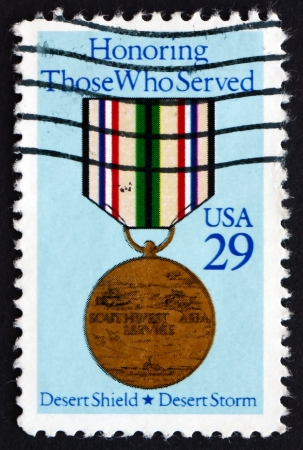 desert storm: USA - CIRCA 1991: a stamp printed in the USA shows Medal, Honoring Those who Served in Operations Desert Shield and Desert Storm, circa 1991 Editorial