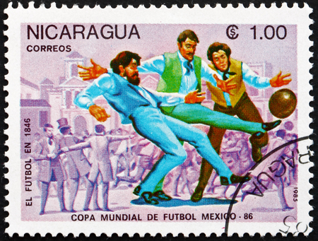 NICARAGUA - CIRCA 1985: a stamp printed in Nicaragua shows Evolution of Soccer, 1846, 1986 World Cup Soccer Championships, Mexico, circa 1985