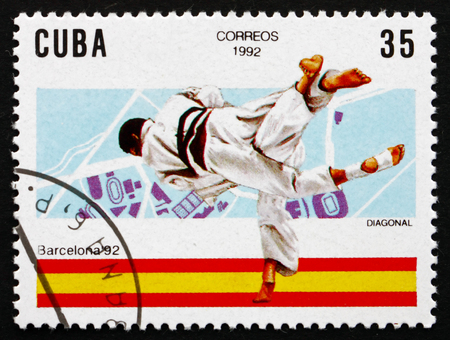 summer olympics: CUBA - CIRCA 1992: a stamp printed in the Cuba shows Judo, 1992 Summer Olympics, Barcelona, circa 1992