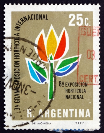 horticultural: ARGENTINA - CIRCA 1971: a stamp printed in the Argentina shows Stylized Tulip, Horticultural Exhibition, circa 1971
