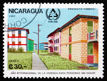 waif: NICARAGUA - CIRCA 1987: a stamp printed in Nicaragua shows Housing, International Year of Shelter for the Homeless, circa 1987