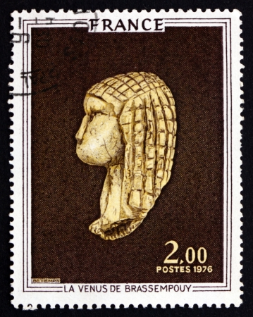 palaeolithic: FRANCE - CIRCA 1976: a stamp printed in the France shows Venus of Brassempouy, Ivory Figurine from the Upper Palaeolithic Discovered in a Cave at Brassempouy, France, circa 1976 Editorial
