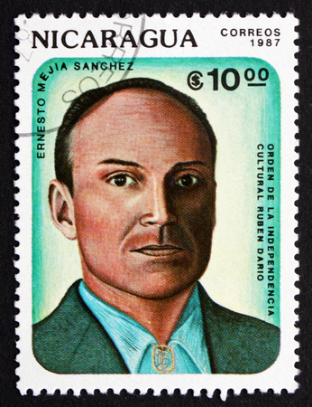 critic: NICARAGUA - CIRCA 1987: a stamp printed in Nicaragua shows Ernesto Mejia Sanchez, Poet and Critic, Winner of Ruben Dario Order of Cultural Independence, circa 1987