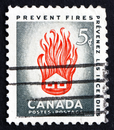 needless: CANADA - CIRCA 1956: a stamp printed in the Canada shows House on Fire, the Needless Waste Caused by Preventable Fires, circa 1956