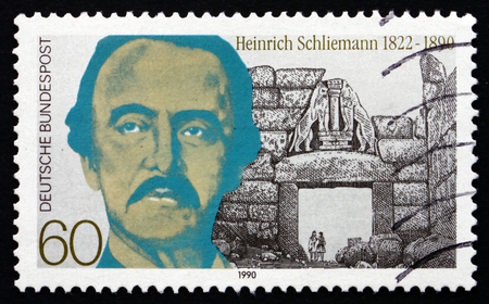 archaeologist: GERMANY - CIRCA 1990: a stamp printed in the Germany shows Heinrich Schliemann, Archaeologist, circa 1990
