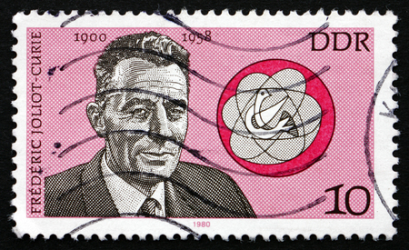physicist: GDR - CIRCA 1980: a stamp printed in GDR shows Frederic Joliot-Curie, French Physicist, Nobel Laureate, circa 1980