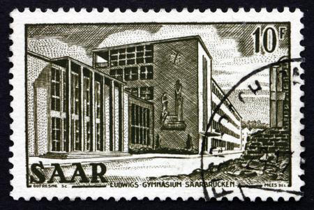 saar: GERMANY - CIRCA 1953: a stamp printed in the Saar, Germany shows Ludwig�s Gymnasium, circa 1953 Editorial