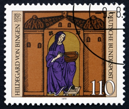 GERMANY - CIRCA 1979: a stamp printed in the Germany shows Hildegard von Bingen with Manuscript, Benedictine Nun, Mystic and Writer,  circa 1979