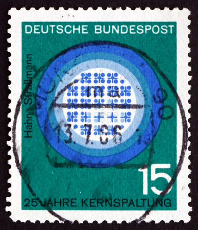 fission: GERMANY - CIRCA 1964: a stamp printed in the Germany shows Cerenkov Radiation, Reactor in Operation, 25 Years of Nuclear Fission, Hahn and Strassmann, circa 1964