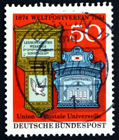 upu: GERMANY - CIRCA 1974: a stamp printed in the Germany shows Swiss and German 19th Century Mail Boxes, Centenary of Universal Postal Union, circa 1974