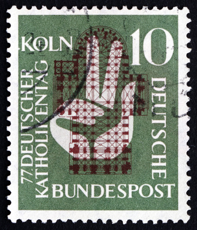 GERMANY - CIRCA 1956: a stamp printed in the Germany shows Plan of Cologne Cathedral and Hand, 77th Meeting of German Catholics, Cologne, circa 1956