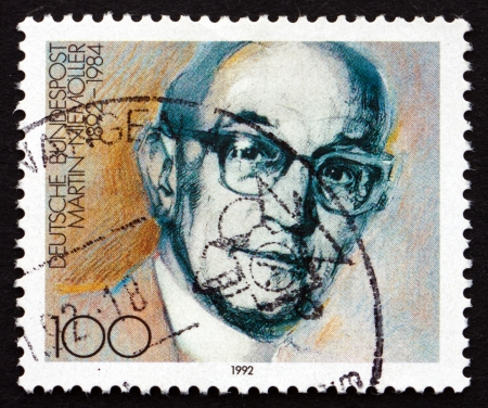 theologian: GERMANY - CIRCA 1992: a stamp printed in the Germany shows Martin Niemoller, Theologian, Lutheran Pastor, circa 1992 Editorial