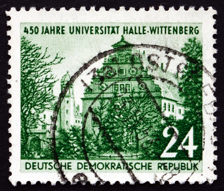 founding: GDR - CIRCA 1952: a stamp printed in GDR shows Halle University, 450th Anniversary of the Founding of Halle University, Wittenberg, circa 1952