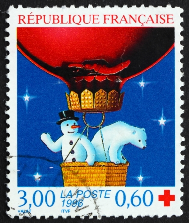 commemorate: FRANCE - CIRCA 1996: a stamp printed in the France shows Snowman and Polar Bear, Christmas, circa 1996 Editorial