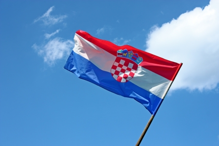 Croatian flag in front of the blue sky photo