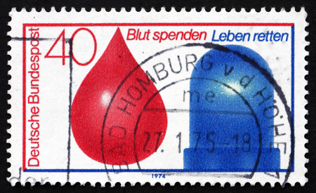 in conjunction: GERMANY - CIRCA 1974: a stamp printed in the Germany shows Drop of Blood and Police Car Light, Blood Donor Sevice in Conjunction with Accident Emergency Service, circa 1974