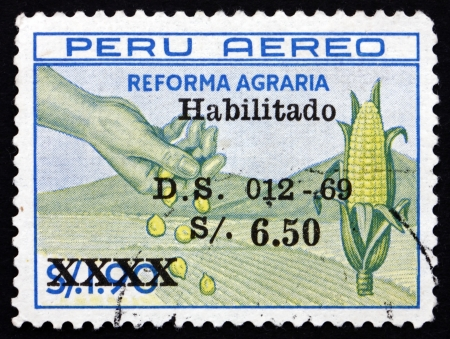 agrarian: PERU - CIRCA 1969: a stamp printed in the Peru shows Hand, Corn and Field, Agrarian Reform Law, circa 1983