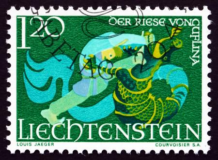 slaying: LIECHTENSTEIN - CIRCA 1967: a stamp printed in the Liechtenstein shows The Giant of Guflina Slaying the Dragon, Fairy Tale of Liechtenstein, circa 1967