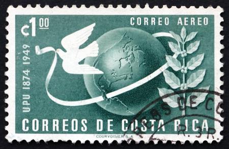 upu: COSTA RICA - CIRCA 1950: a stamp printed in Costa Rica shows Dove and Globe, Symbols of UPU, 75th Anniversary of the UPU, circa 1950 Editorial