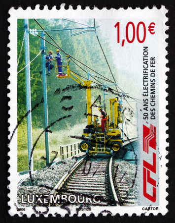 LUXEMBOURG - CIRCA 2006: a stamp printed in the Luxembourg shows Railway Workers Repairing Electrical Wires, Electrification of Railway Network, 50th Anniversary, circa 2006