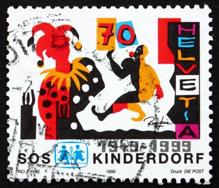 helvetia: SWITZERLAND - CIRCA 1999: a stamp printed in the Switzerland shows SOS Children's Village, Wabern, 50th Anniversary, circa 1999 Editorial