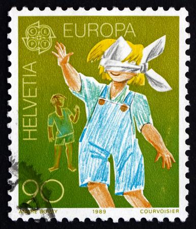 buff: SWITZERLAND - CIRCA 1989: a stamp printed in the Switzerland shows Blindman's Buff, Children's Game, circa 1989