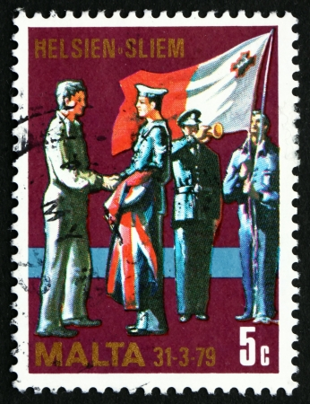 MALTA - CIRCA 1977: a stamp printed in the Malta shows Changing of Colors, End of Military Agreement between Malta and Great Britain, circa 1977